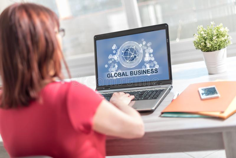 Global business concept on a laptop screen royalty free stock photo