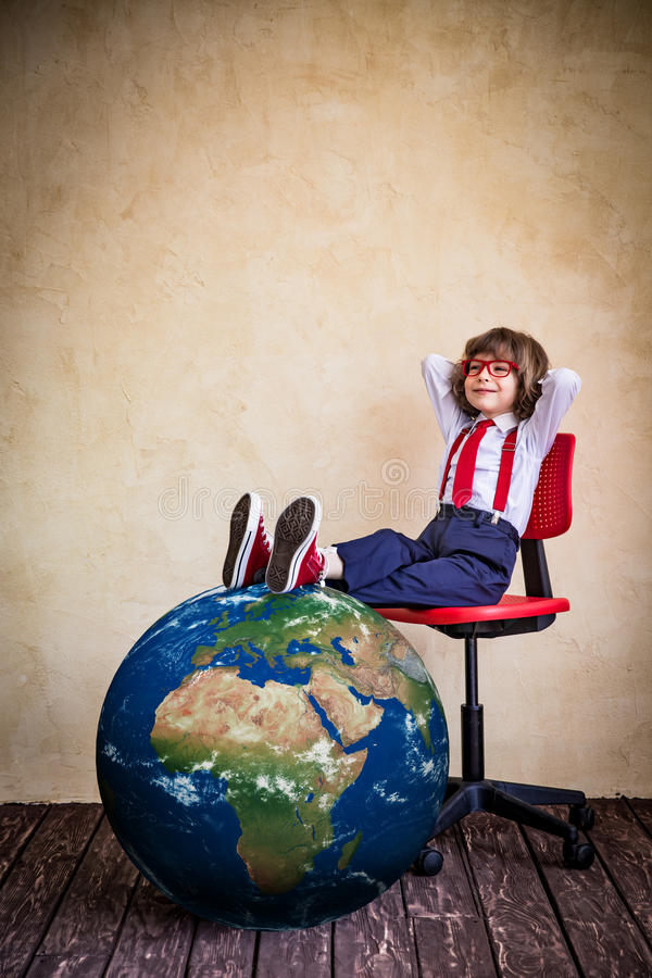 Global business concept. Portrait of young businessman kid in office. Global business concept. Elements of this image furnished by NASA royalty free stock images