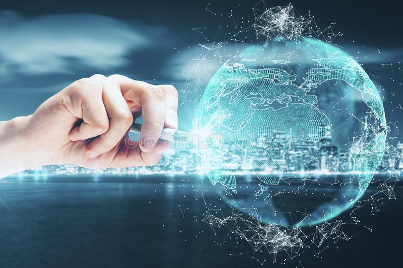 Global business and network concept. Close up of hand drawing creative polygonal globe on blurry night city waterfront background. Global business and network stock images