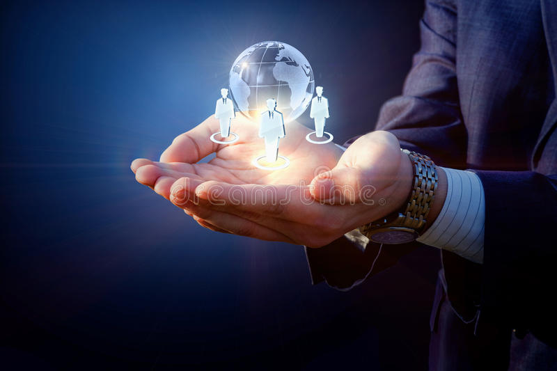 Global business team . Global business team in the hands of a businessman stock image