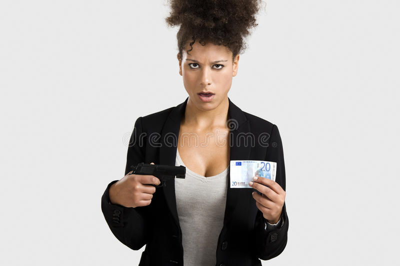 Global crises. Businesswoman shooting a euro banknote, great concept for the global crises stock images