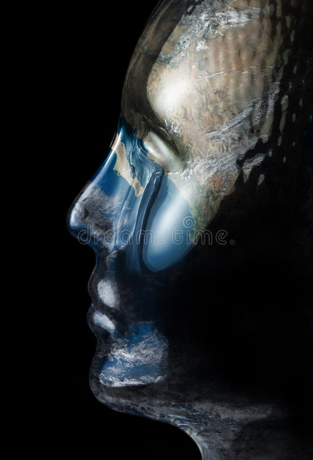 Global glass head. Translucent reflective human head made of glass with global surface on it in black back royalty free stock photography