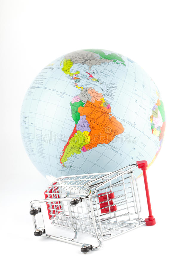 Global Market. Globe with cart on the white royalty free stock images