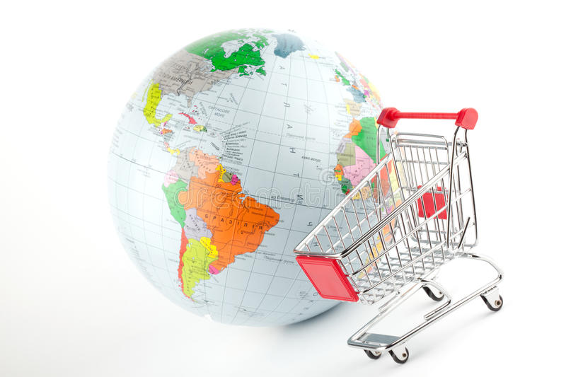 Global Market. Globe with cart on the white stock images