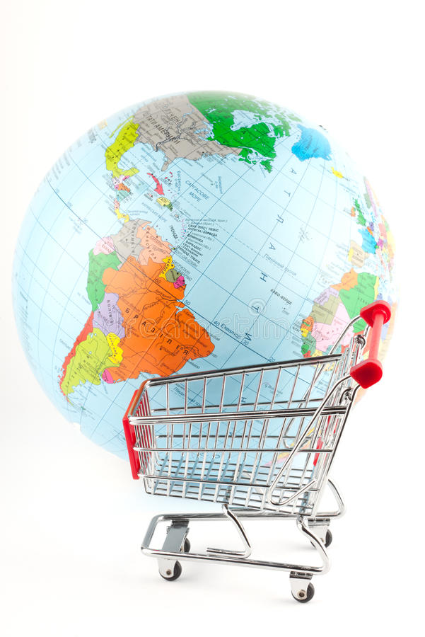 Global Market. Globe with cart on the white royalty free stock photos