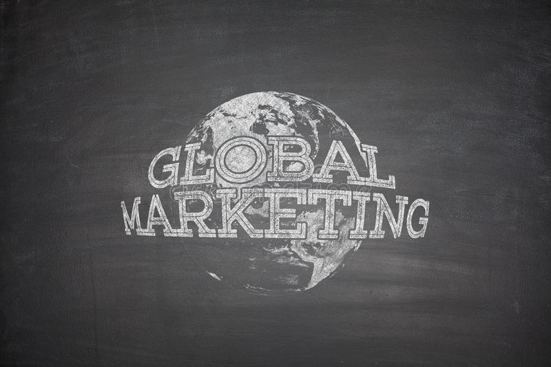 Global marketing concept on blackboard stock image