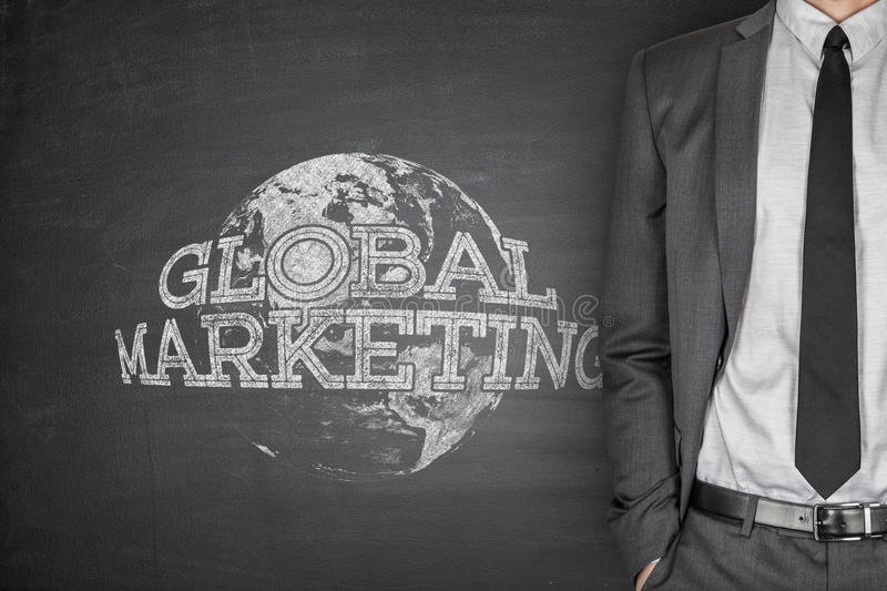 Global marketing concept on blackboard stock photography