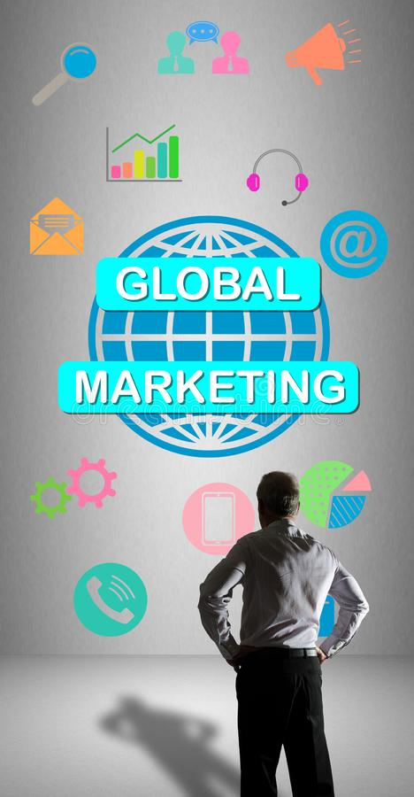Global marketing concept watched by a businessman. Businessman watching a global marketing concept drawn on a wall stock illustration