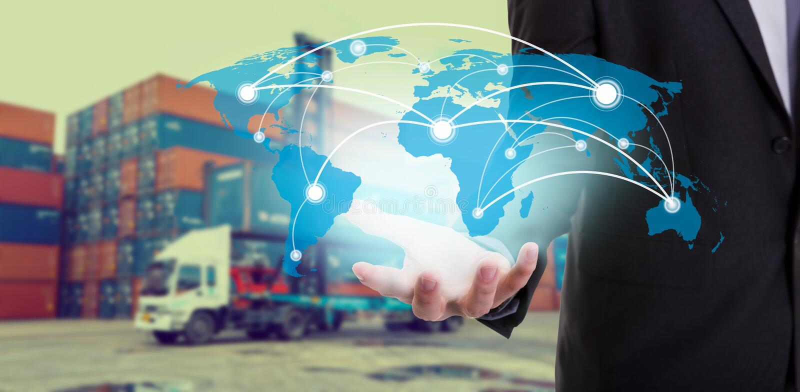 Global network coverage world map on hand of businessman ,Industrial Container Cargo freight ship at habor for Logistic Import Ex royalty free stock photo