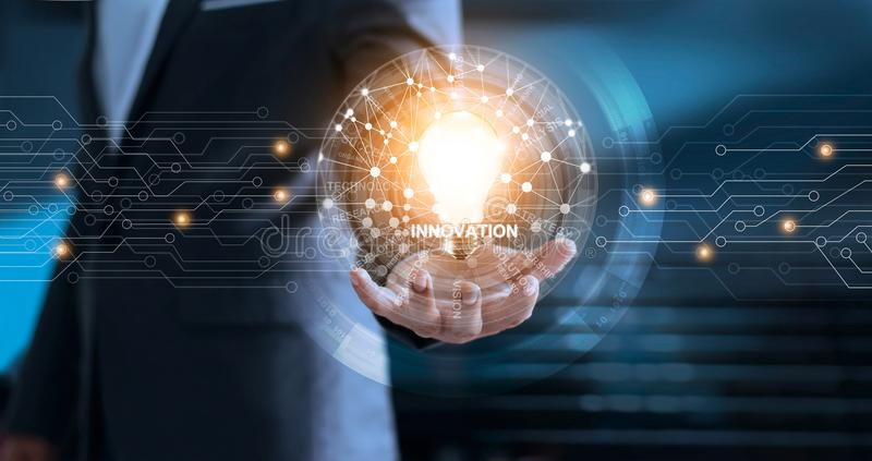 Global network innovation and technology concept. Innovation and technology concept. Businessman holding light bulb with global network connection and word of