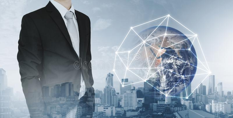 Global network and international global business. Double exposure businessman and city background with global network connection h stock image
