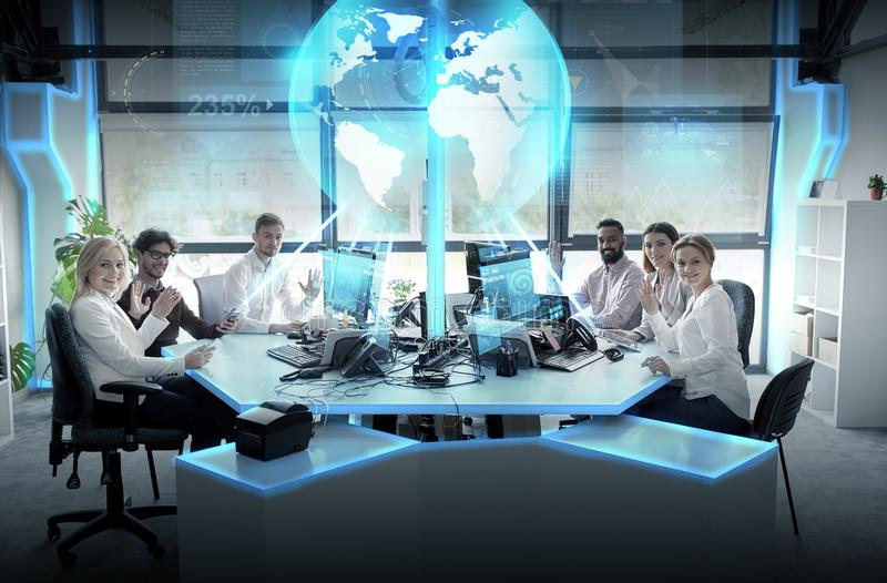 Happy business team with earth hologram at office royalty free stock photos