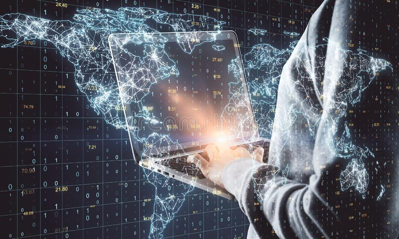 Global network and theft concept. Hacker using laptop with glowing polygonal map on grid binary code background. Global network and theft concept. Double royalty free stock photography