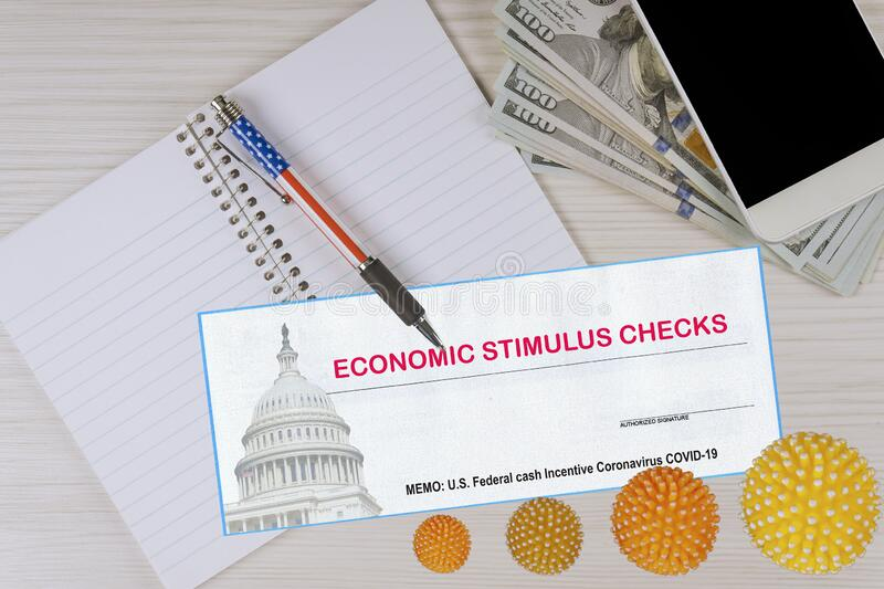 Global pandemic Covid 19 lockdown Federal monetary assistance stimulus U.S. economic tax return check USA dollar cash banknote. Federal monetary assistance royalty free stock images
