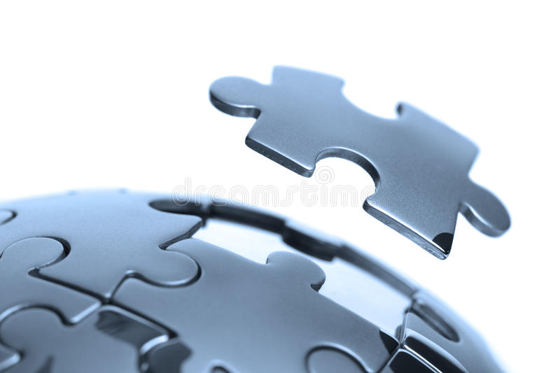 Global solution. Last piece of a global puzzle concept for business solutions and strategy stock photography