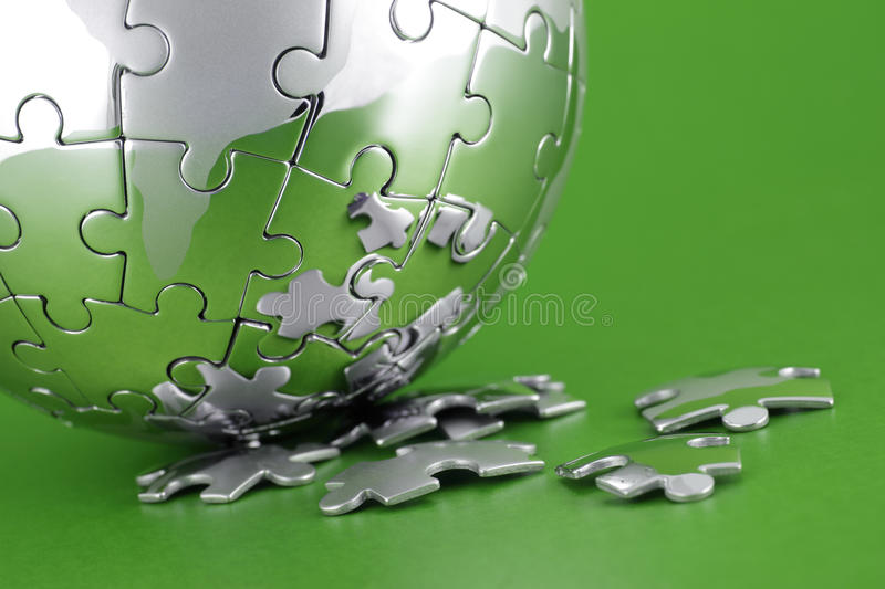 Global strategy. Global environment solution concept - earth jigsaw puzzle stock image