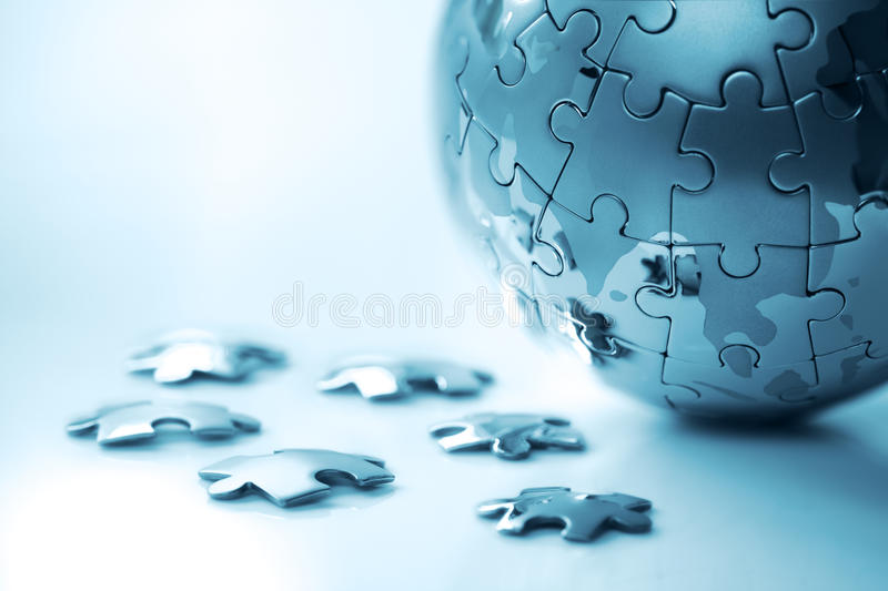 Global strategy. Solution concept - earth jigsaw puzzle royalty free stock photos