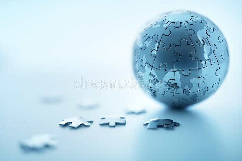 Global strategy. Solution concept - earth jigsaw puzzle royalty free stock photo