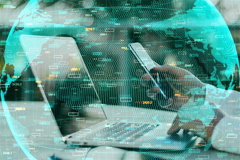 Global trade and network concept. Side view of hands using laptop and smartphone with forex chart and globe. Global trade and network concept. Double exposure stock photo