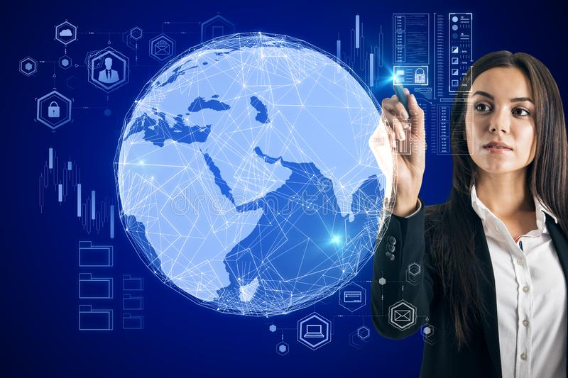 Global trading concept with business woman touching digital searth globe stock images