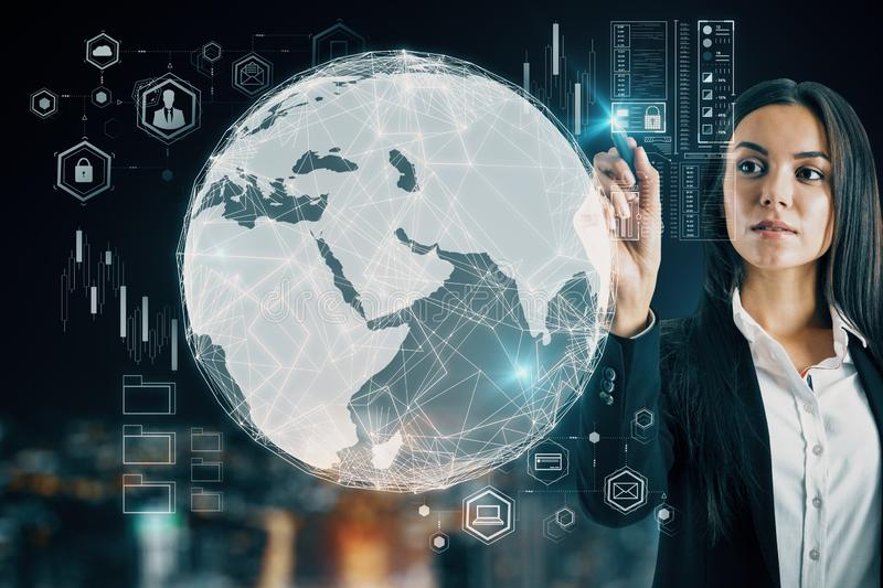 Global trading concept with trader woman and digital screen with earth globe stock image