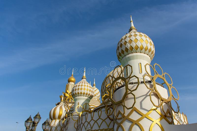 Global Village tourist attraction in Dubai representing global shops and fun looking upwards at a the Russian buildings and tradit stock photography