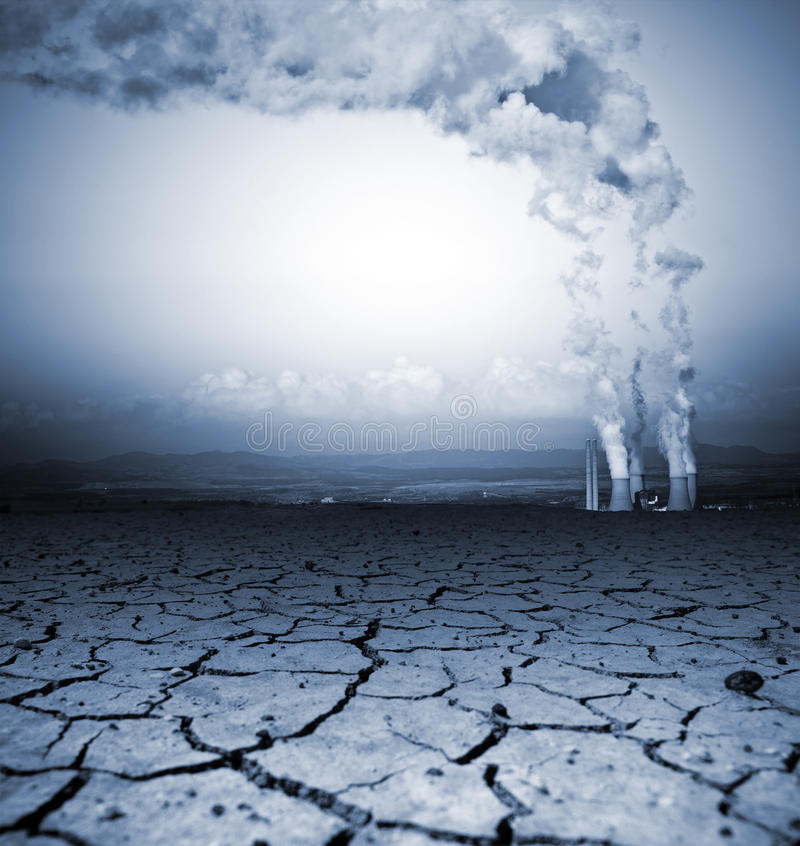Global Warming. Badly cracked earth with power station stock image