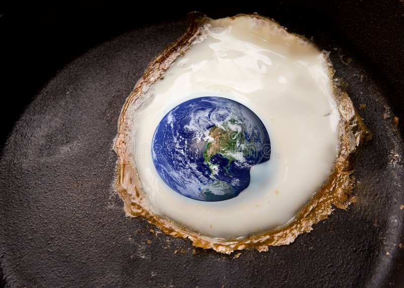 Global Warming. Concept image with the world being fried in a frying pan like an egg stock image