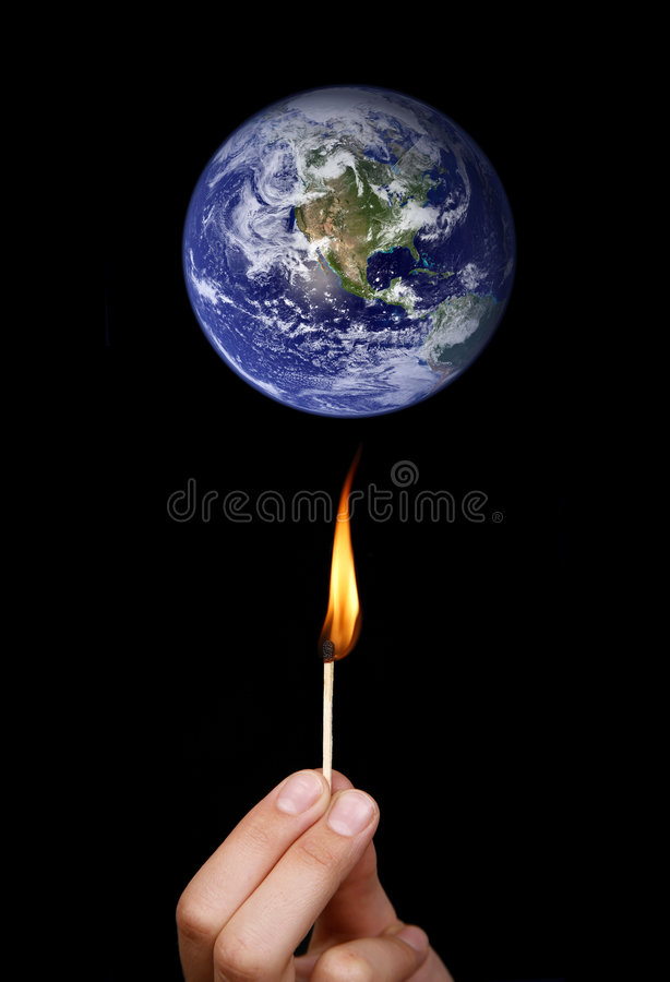 Global warming. Concept: match stick burning the world (nasa imagery stock photography