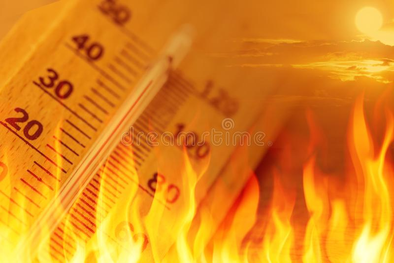 Global warming climate change sign high temperature. Thermometer fire concept royalty free stock images