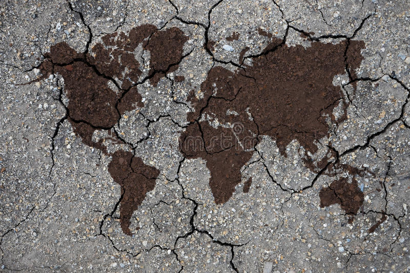 Global warming concept world map. Dry clay texture and world map, concept for global warming stock image