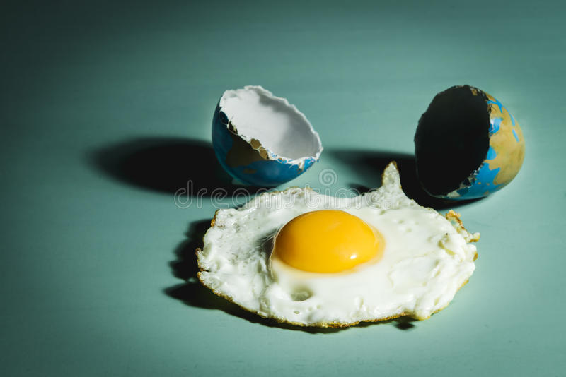 Global Warming. Conceptual image representing global warming with an egg painted like a earth