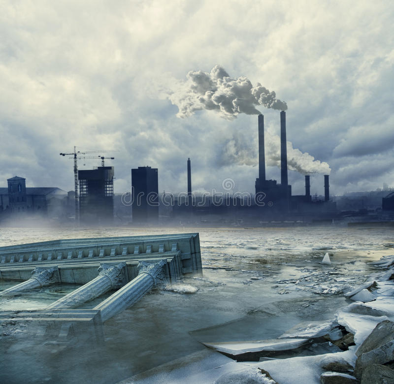 Global warming. Dark global warming concept with frozen ruins and factory polluting the air in the background royalty free stock photo