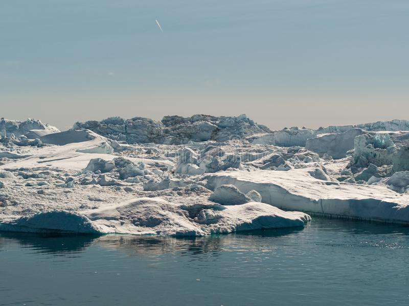 Global warming -Greenland Iceberg landscape of Ilulissat icefjord with giant iceberg stock photos