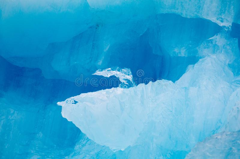 Global warming melting glacial ice. On Alaskan glaciers  give deep blue colors and bizarre shapes and patterns royalty free stock photos