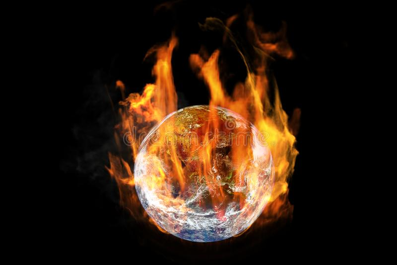 Global Warming and Pollution Concept : Fire burning planet earth globe isolated on black background. royalty free stock photo