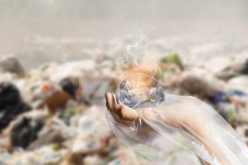 Global Warming and Pollution Concept - Sustainability Elements of this image furnished by NASA. The concept of World Environment Day.  the earth in a plastic stock photography