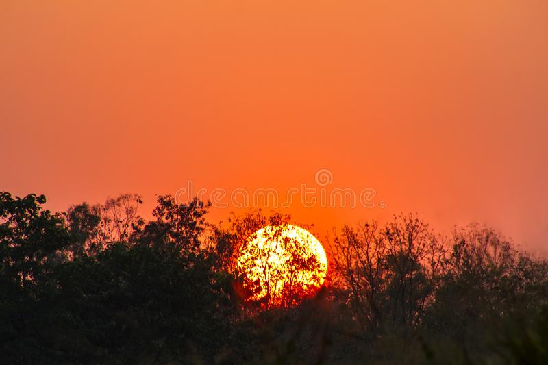 Global warming from the sun and burning, heat wave hot sun, climate change. Heatwave hot sun, makes heat stroke background bright carbon celsius city concept royalty free stock photography