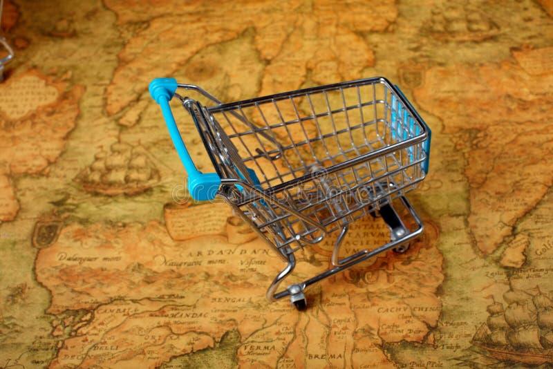 Globalización del carro de la compra del mundo stock de ilustración