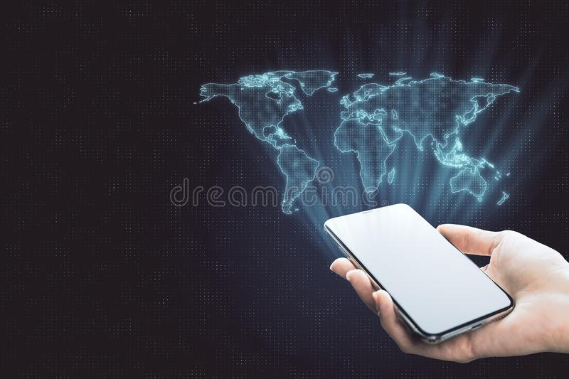 Globalization concept with digital world map. From smartphone in human hand at abstract background stock photography