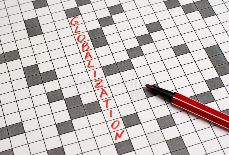Globalization. Text in crossword. Red letters royalty free stock photos