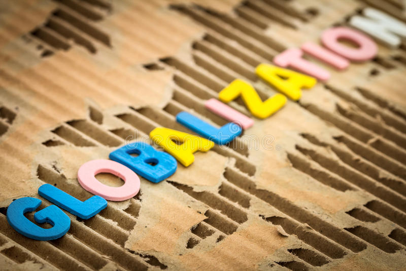 globalization wording on abstract torn cardboard background, selective focus stock image