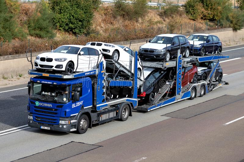 Globay truck on motorway. Globay is group of companies that provide automobile logistics solutions for car manufacturers, dealers and used car sellers stock photo