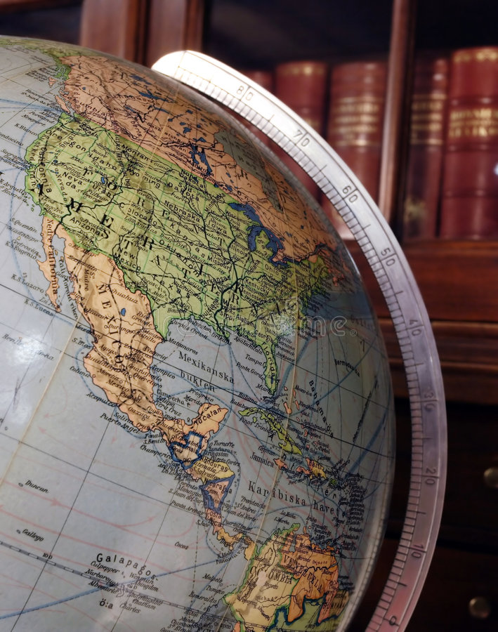 Globe. Library ambiance, Globe and books royalty free stock photos