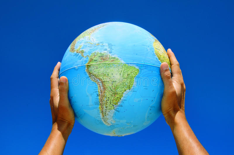 Globe. Someone holding a globe in his hands royalty free stock photo