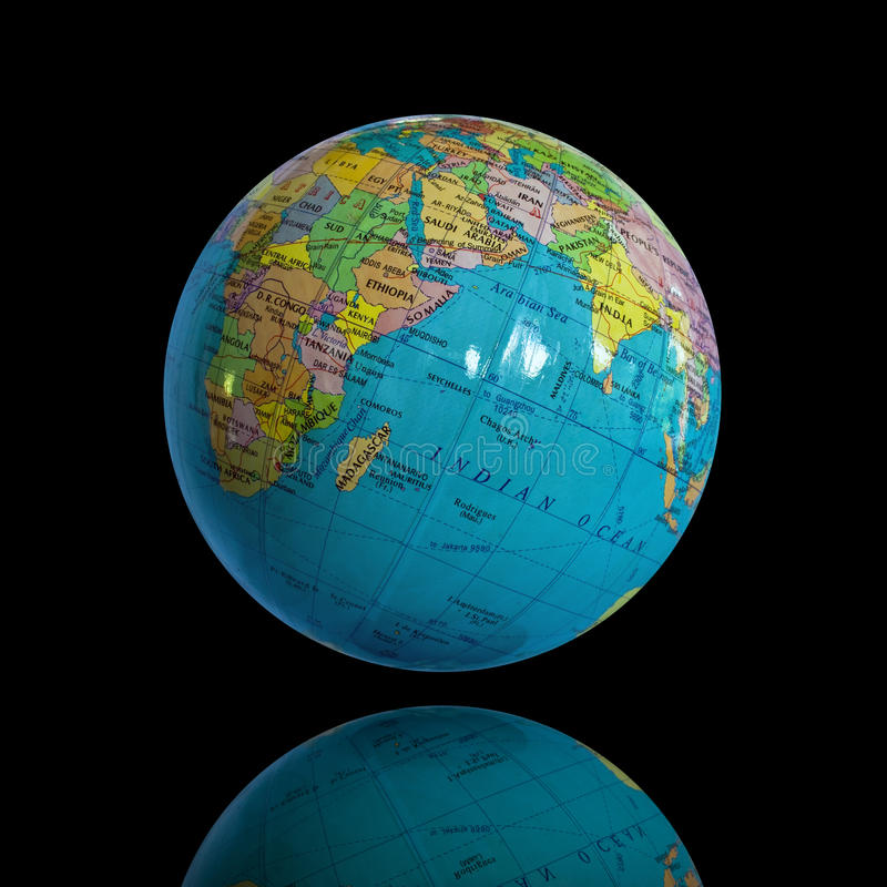Globe. Small globe and shadow isolated on black background stock image