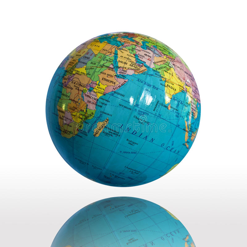 Globe. Small globe and shadow isolated on white background royalty free stock photos