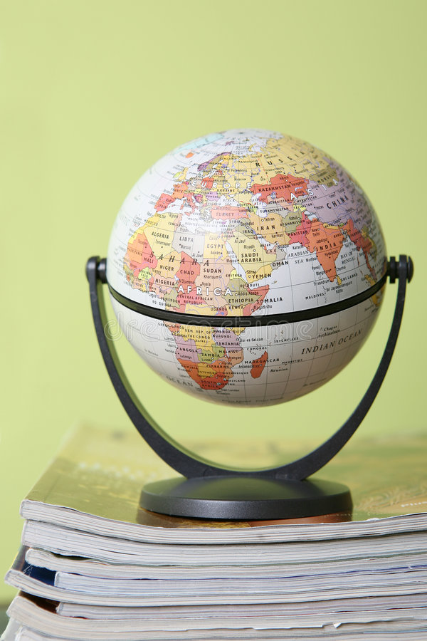 Globe. On stack of newspaper stock image