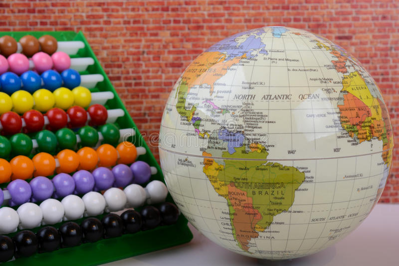 Globe and abacus stock image