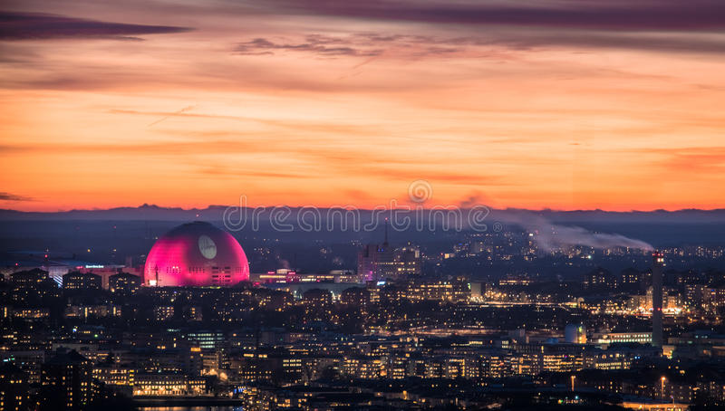 Globe arena building illuminated in pink against sunset sky during Christmas holiday season. 18 December 2016, Stockholm, Sweden. Globe arena building stock photography